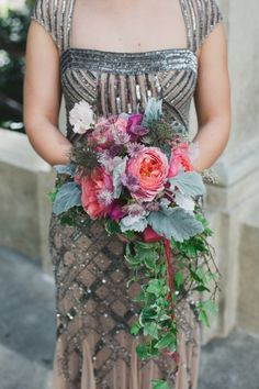 Love the pink and purple cascading bouquet .... And the dress!  It is so beautiful and unique for a wedding.