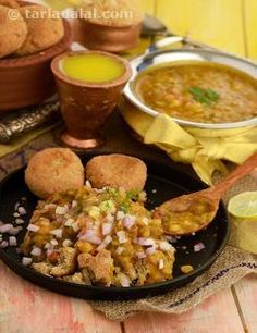 Rajasthani food is incomplete without the mention of the famed Dal-Baati-Churma. What started as a picnic food has become a distinctive cuisine of the State. It consists of baatis or flaky round breads baked over firewood or over kandas (i.e. cow dung cakes) as done in villages. Baatis can be baked in a gas tandoor or an electric oven as well. Bafla or steamed baatis are also very popular.  But one thing common for baatis, irrespective of their cooking technique is that they are always ...