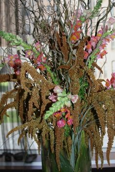 Stunning autumn floral arrangement with a lush brown and green colors and branches.  Created by Matles Florist in NYC.
