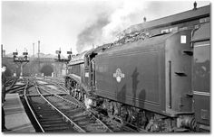 A heavy express for Leeds is slowly drawn out of Kings Cross behind Pacific 60013 'Dominion of New Zealand'. Even in the final months of steam traction, Kings Cross still managed to keep its locomotives in fine shape. Diesel Locomotive, Steam Locomotive, Steam Railway, British Rail, Train Engines, Train Journey, Steamers, Steam Engine, Train Station