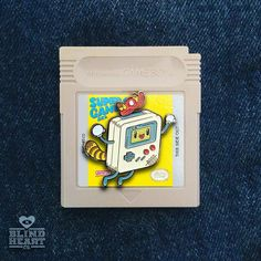 Is that our brand new #lapelpin by @bearbrains with an actual game cartridge for a backer? Perhaps... Available now at http://blindheart.co (link in bio)  #lapelpins #pins #mario #gameboy #bearbrains #bmo #pingame #videogames #nes #blindheartco # # by blindheartco