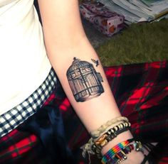 An easy and meaningful bird cage tattoo idea.