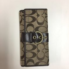 Coach Wallet with checkbook-GUC! Coach Wallet with checkbook. This wallet has been gently carried, but remains in really good condition! Coach Bags Wallets