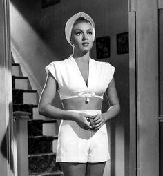 "Lana Turner pulls of the turban in ""The Postman Always Rings Twice"""