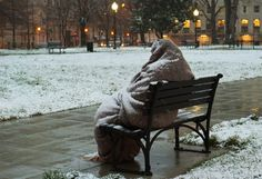 A homeless man sits coated in snow early on March 25 in Washington, D.C. A messy Monday was in store for millions along the East Coast, with winter weather advisories warning of a mixture of snow and rain for Washington, Philadelphia, metropolitan New York and parts of northeast New Jersey.