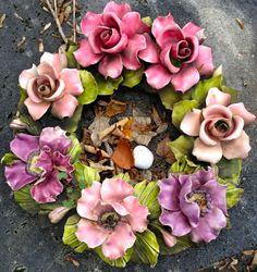 Majolica wreath contaning the Famous French Ceramic Flowers. Contact Keramiek voor buiten for more information on these Famous French Ceramic Flowers