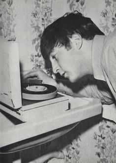 John Lennon using an extremely high tech music playback system… note the well thought anti-vibration system