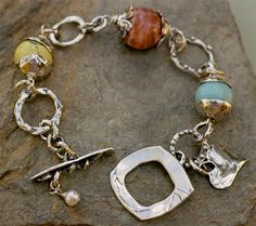 Spring Trio Peach Moonstone, Amazonite and yellow turquoise. Handcrafted sterling silver components.  Bracelet fits a wrist size 6.25 to 6.75 - Actual bracelet size is 7.5 inches  An Original Artisan Handcrafted bracelet by Cathy Dailey