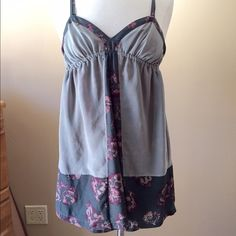 Urban Outfitters Silence + Noise Dress Cute gray dress with pink/gray floral pattern. See close up photo for tear at front B. Sold as is and priced accordingly. Pinned on size 6/8 mannequin (37-26-37)Check out the $6 section near the bottom of my closet (before the sold items) for lots of bundle-worthy $6 items! 15% bundle discount on 2+ items in a bundle.NO TRADES Urban Outfitters Dresses
