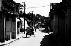 Photo taken on the street in the ancient town of Hoi An in 2001.