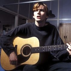 A young David Tennant with a guitar!