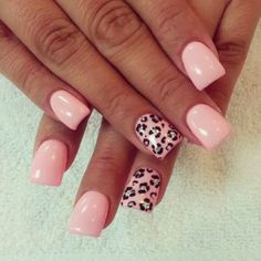 Pastel pink nails with leopard print ring finger design