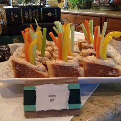 Book Club food idea...made these for last night's meeting. Sliced baguette and scooped out some of the center. Filled the center with hummus and stuck in sliced carrot, celery & yellow bell pepper. Called it Moby Dip.