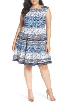 Free shipping and returns on Gabby Skye Paisley Stripe Fit & Flare Dress (Plus Size) at Nordstrom.com. A waist-slimming silhouette tailored from a smooth scuba knit flaunts a global-chic print in cool blue tones.