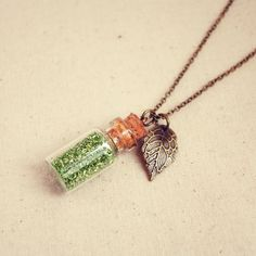 Little Glass Bottle Necklace with Green Glitter and Tiny Leaf