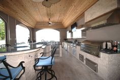 """Custom 46 foot Kitchen, Travatine stone, 48"""" DCS Grill with Vent hood, True refrigerators, Blanco sinks, ovens and warming drawers by Outdoor Dreamscapes."""