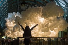 A Suspended Cloud of 100,000 Illuminated Balloons Hanging Inside Covent Garden by Charles Pétillion