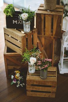 Crates and jars of blooms to add a rustic vibe // This rustic and relaxed affair, captured by Fire Wood and Earth and planned by Bozza Event Organiser, perfectly combined the green surroundings of Padma Hotel Bandung with wood crates, barrels, lush leaves, and garlands.