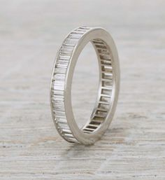 Vintage eternity wedding band made in platinum and set with approximately 2.25 carat baguette cut diamonds. Signed Van Cleef & Arpels. Circa 1920