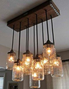 Fun lighting over bar or tables in restaurant -  DIY - Mason Jar Chandelier #diy #lights #dan330 http://livedan330.com/2015/03/03/diy-mason-jar-chandelier/