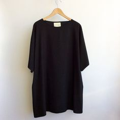 The Tomiko tunic is a longer version of the kimono crop, with the addition of side pockets. A comfortable layering piece over pants or skirts, it is meant to be worn and enjoyed everyday. The pattern is roomy and over-sized, with a dropped kimono sleeve. The raw silk in this piece is super soft, wit