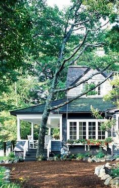 lovely navy blue cottage in the woods, I love the deep front porch