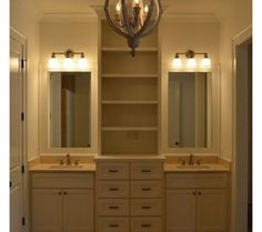 bathroom vanity with linen tower in center | Bathroom Storage And Vanities