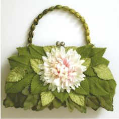 various textures for the leaves on this handbag  Would be beautiful on the back of a door in bathroom.  Close the door what a nice surprise!