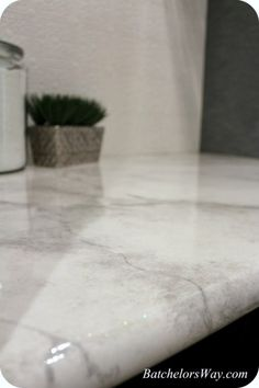 DIY faux marble countertops made with paint and and a glossy epoxy glaze