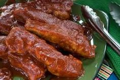 """Country BBQ Rib Meal For A Quick No Clean Up Meal  Line Sides and Bottom of a 13"""" X 9 """" Cake Pan with foil, so there is no seams in foil. Lay out Country Pork Ribs on foil. Smother with Baby Rays BBQ Sauce Cover top with foil and seal well. Bake for 1 1/2 in over at 350'  Serve, Carefully throw foil away. Pan should be clean. You can Bake Corn on the cob 30 min's and potatoes 1 hour  wrapped in foil as side dishes. Add to oven while ribs are baking."""
