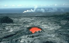 Skylight reveals lava flowing through tube to the sea, Kilauea Volcano, Hawaii