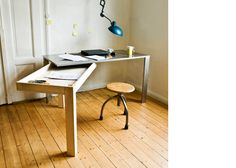 wooden table swings out to create another workspace by stephan schulz. so sick