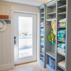Closet full of beach towels right at hand at this Myrtle Beach, South Carolina home renovated by CRG Companies (via House of Turquoise).