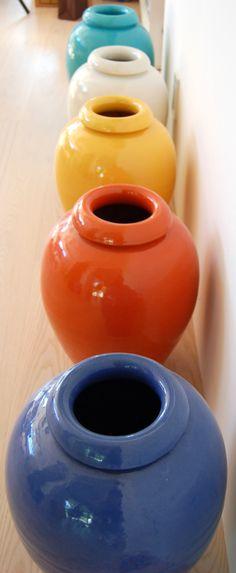 Rainbow of vintage Bauer 16-inch oil jars