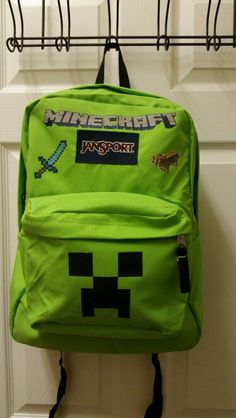 DIY Minecraft backpack. I used iron on transfer paper and printed the images off the computer.