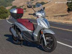See the 2013 Piaggio BV 350 in action in the 2013 Piaggio BV 350 Review photo gallery. Motorcycle Parts, Vespa, Scooters, Photo Galleries, Wheels, Action, Bike, Gallery, Vehicles