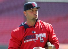 St. Louis Cardinals outfielder Matt Holliday talks with teammates during practice on Sunday afternoon, March 30, 2014, at the Great American...