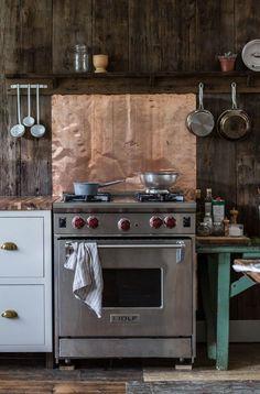 Copper flashing sheet as backsplash Catskills-Farmhouse-kitchen-by-Jersey-Ice-Cream-Co-Remodelista-2_0-733x1113