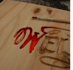 Wood carving with Dremel tools - could fill this with blood coloured resin, would make a creepy signpost for Halloween!