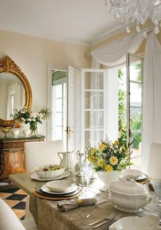 A touch of old world with modern design: simple moldings surround the doors, light wall colors (not aged plaster or stone.....but yet evocative enough), light woods with old world stylings. Love the curtain over the door!