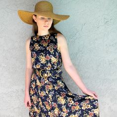 Casual floral summer dress and straw hat.