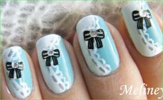 Disney's Alice in Wonderland nail art - Alice's dress with lace and black bows