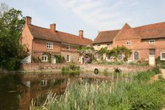 Flatford Mill is a Grade I listed watermill built in 1733 in Flatford, East Bergholt, Suffolk, England.