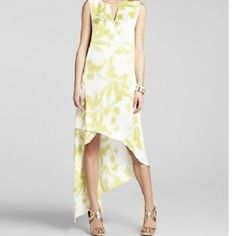 Bcbg dress Long white and green flowered BCBG dress never been worn with tags perfect for spring and summer ; size 4 fits 6 BCBGMaxAzria Dresses