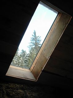 A skylight installed ina log cabin loft. photo by rabbie on Flickr