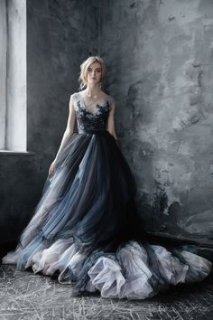 Dramatic black embroidered silver, grey, blue and black tulle ballgown wedding dress; Featured Dress: CarouselFashion