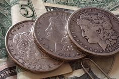 Tips on how and when to invest in silver dollars, and if they even make a good investment. You'll also learn about silver dollar values and bullion prices.
