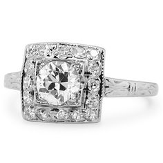 The Lorena Ring from Brilliant Earth. Definitely would look so much prettier with a princess cut in the middle!!!!