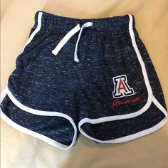 University of Arizona sporty shorts Looks like they should be worn high waisted. Fits very small Shorts