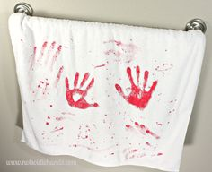 Fun and Easy Halloween Bloody Hand Print Towel @NotSoIdleHands.com